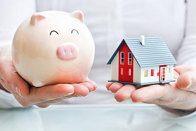 Haus und Sparschwein - Baufinanzierung